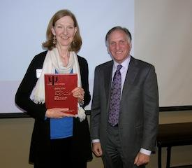 Cynthia Hockett, PhD, winner of the book raffle, with MPA convention speaker Peter Lichtenberg, PhD.