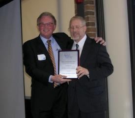 MPA President Dane VerMerris, EdD, presents the MPA Distinguished Psychologist Award to Alan Lewandowski, PhD.