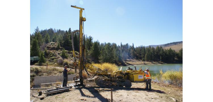 Drilling for foundation grouting at earth dam near Kremmling, CO - Michael W. West and Assoc., Inc.